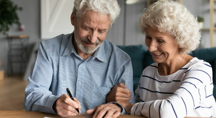 Elderly couple sign a joint will