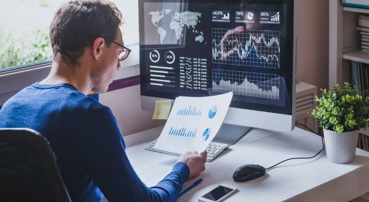 An investor reads a financial report.