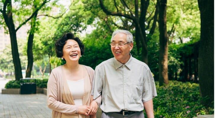 Asian couple taking a walk outside.