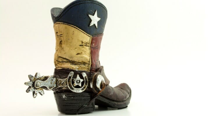 Cowboy boot and spurs, with the upper leathers as a flag of Texas