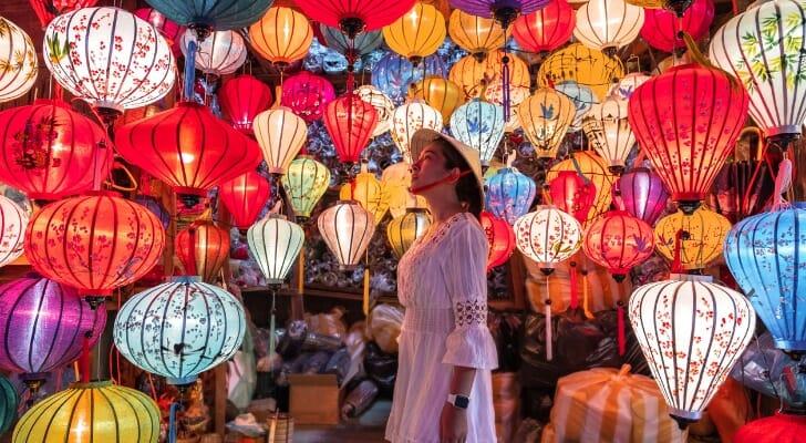 Woman choosing lanterns in Hoi An, Vietnam