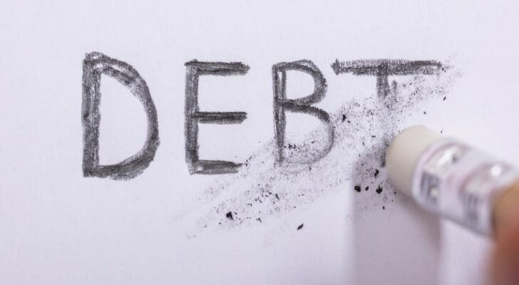 """The word """"DEBT"""" being partially erased"""