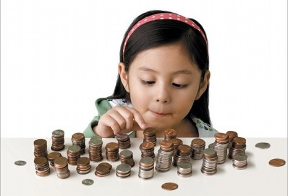 Child counting piles of coins - The High Cost of Having Kids