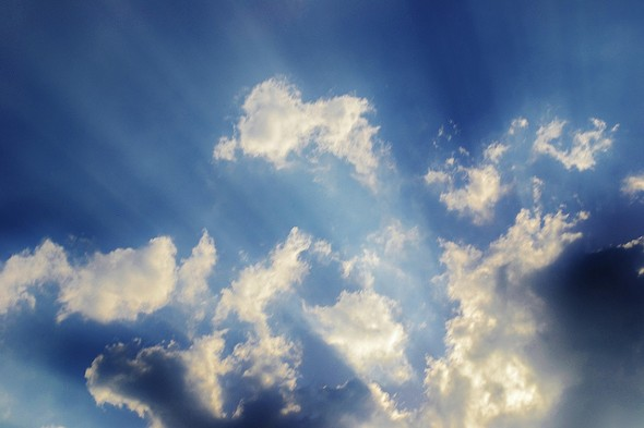 Sky with clouds and rays of light - Want to Retire Early? Avoid These 5 Roadblocks