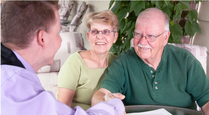 A couple finalizes their estate plan with their attorney