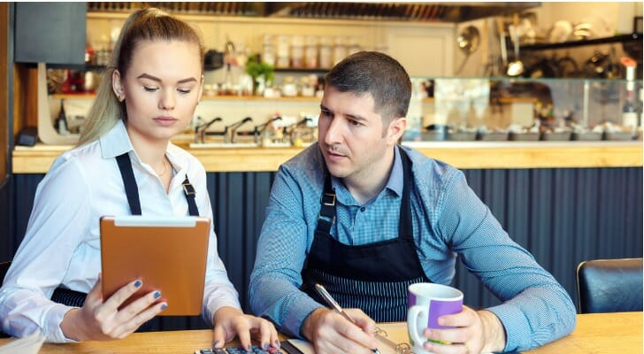 Restaurant owners discuss the finances of their business