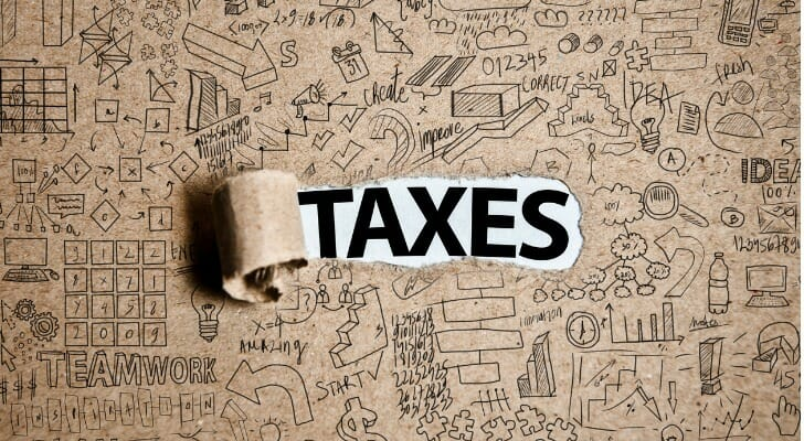 """The word """"TAXES"""" on a piece of paper"""