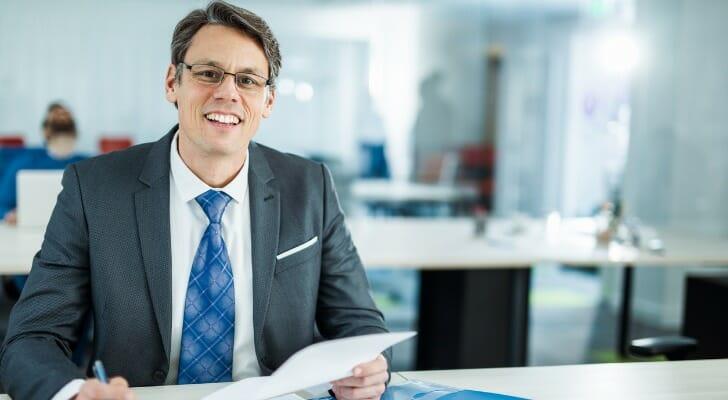 an insurance agent reviews reinsurance paperwork