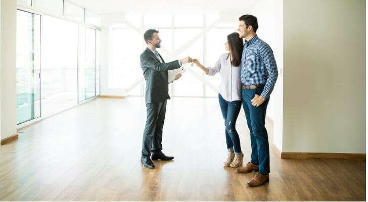 How do real estate agents get paid?