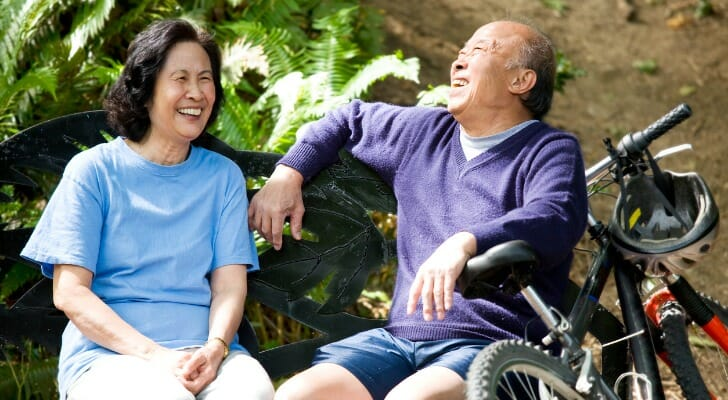Elderly Asian couple enjoying being outdoors