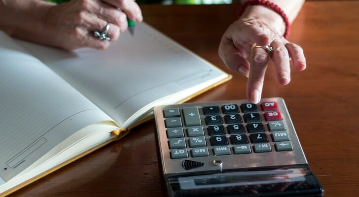 Elderly woman calculates her Social Security benefits