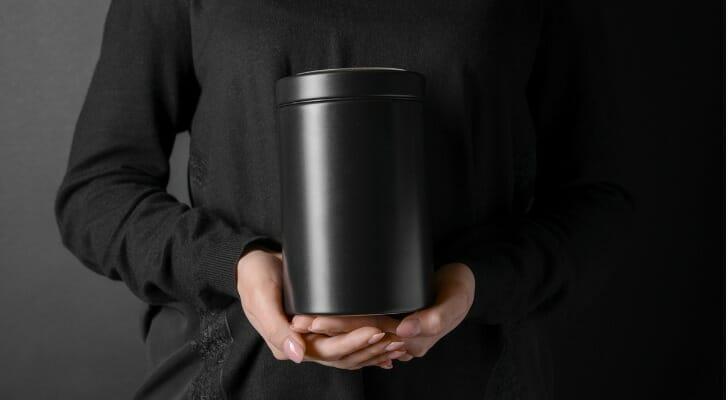 Woman holding crematory urn