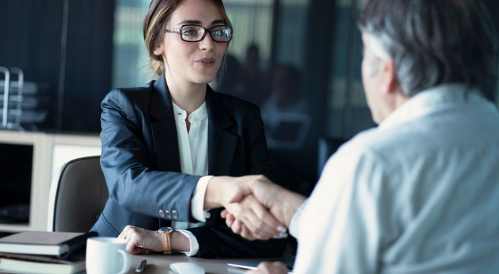 Image shows a client shaking the hand of a financial advisor. Interviewing potential advisors is imperative when hiring a financial advisor.