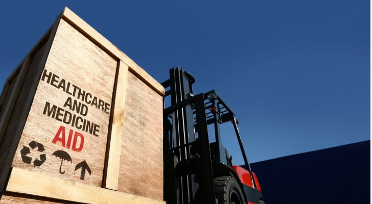 Medical aid in a large container being moved by a forklift