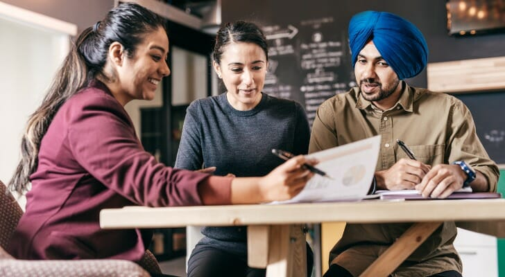 Small business owners review a short-term loan application