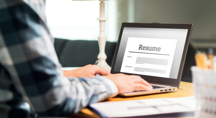 Image shows the hands of a person editing a resume file on a laptop. SmartAsset analyzed BLS data to conduct this year's study on the fastest-growing job in each state.