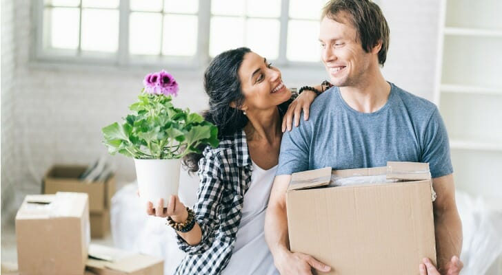 Image shows two high-earning young professionals moving into a new home. SmartAsset analyze data from the IRS to conduct its 2021 study on where rich young professionals are moving.