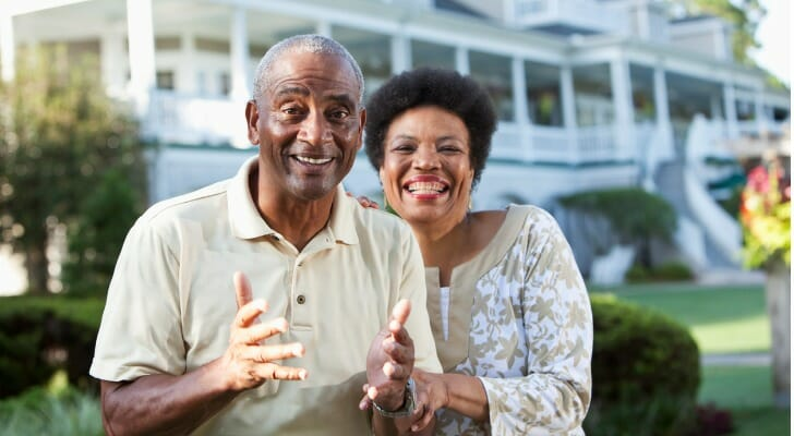 Mature African-American couple at a country club