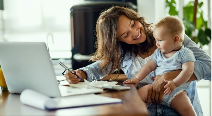 Businesswoman with her baby