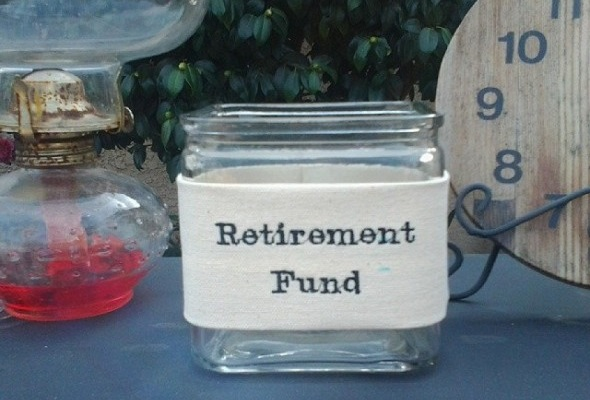 Jar with a label saying retirement fund - Saving for Retirement When Self-Employed