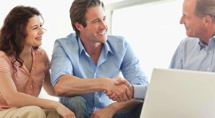 Couple talks with their financial advisor