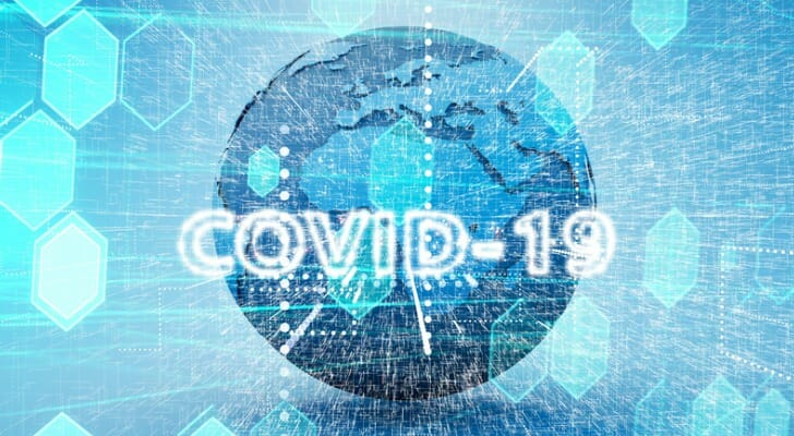 """Picture of Earth with """"COVID-19"""" superimposed on it"""