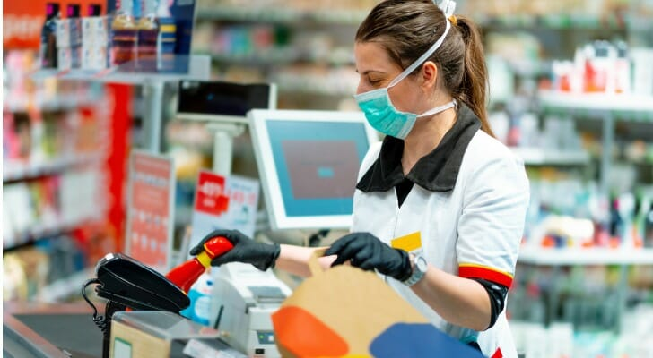 A cashier with mask and gloves