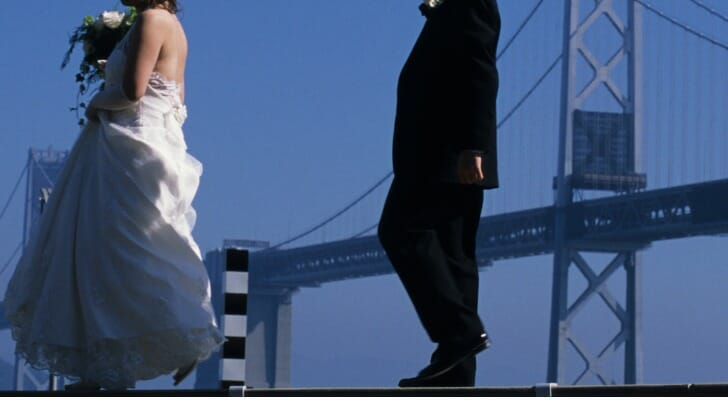 Bride and groom with Golden Gate Bridge in the background
