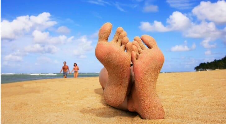 Sandy feet on a tropical island beach