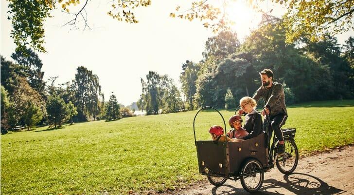 Danish family cycling through a park