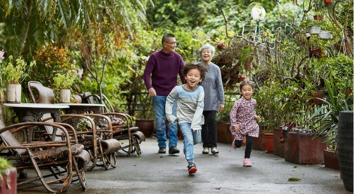 Retirees in China with their grandchildren