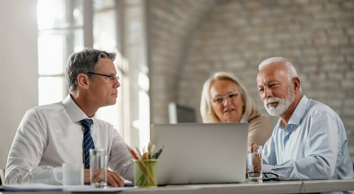 Couple discusses life insurance with an agent