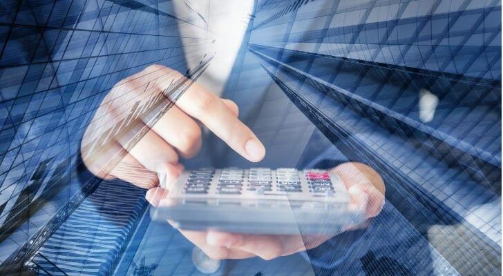 Businesswoman calculates financial metrics