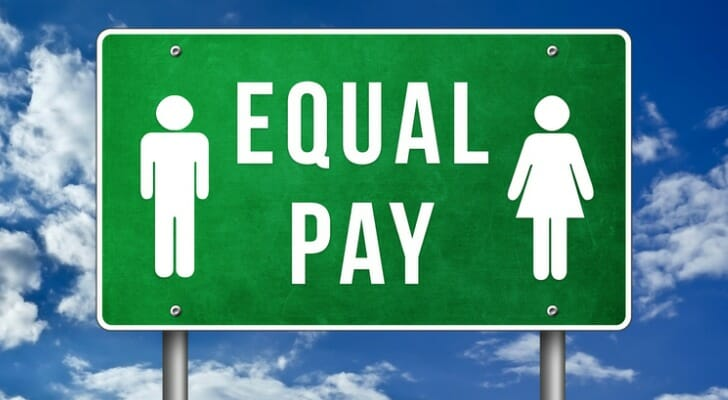"""An """"EQUAL PAY"""" sign"""