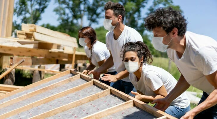 Corporate volunteers building a house for a poor family