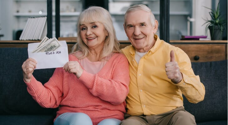 Retired couple with their Roth IRA money