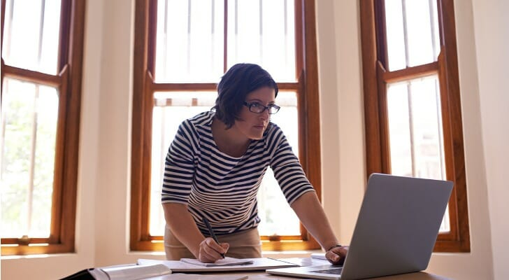 An insurance agent prepares a proposal for her clients