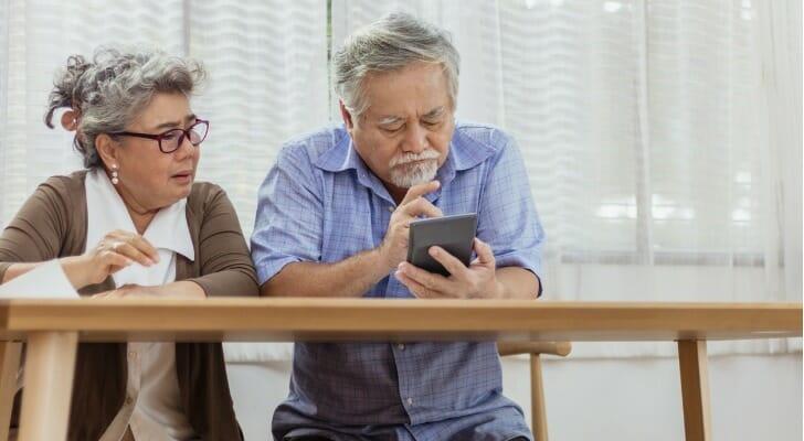 Elderly couple figures their taxes