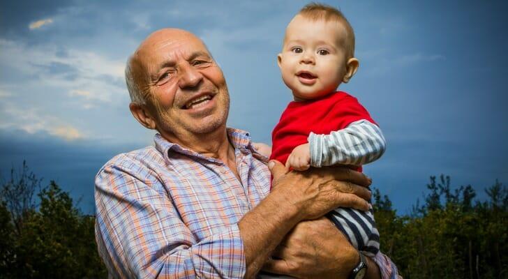 Grandfather holding grandson
