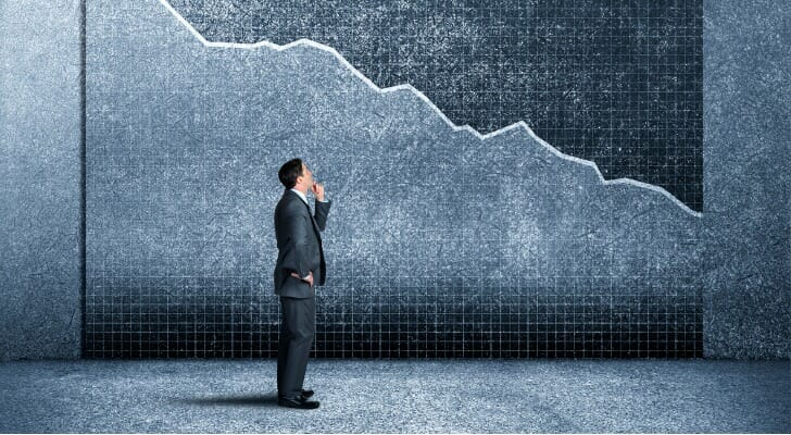 An investor looks at a stock price chart