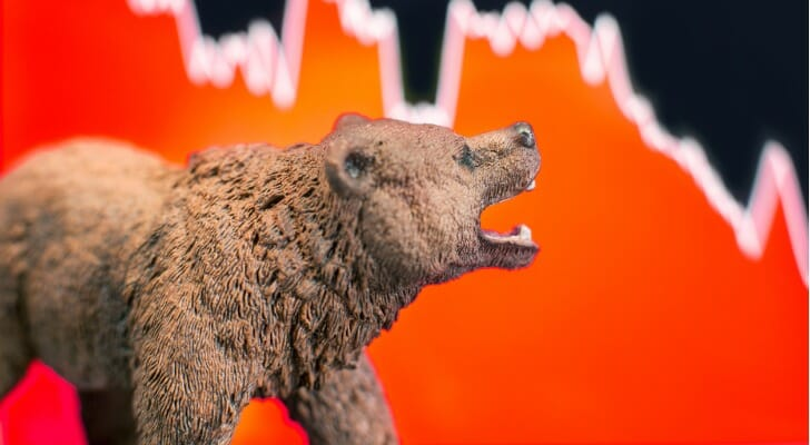A bear with a stock chart in the background