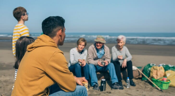 Three generations of a family on the beach