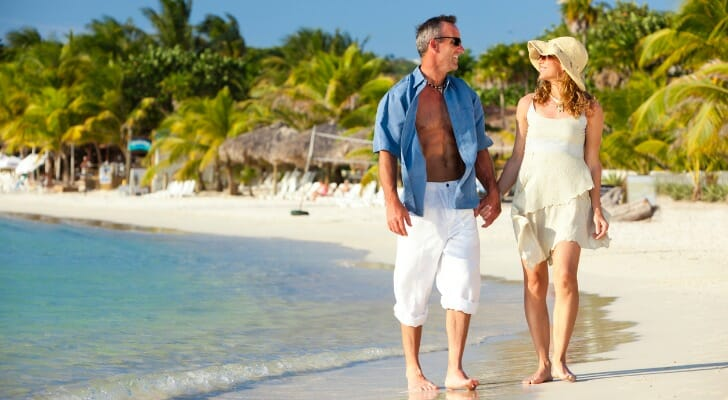 American retirees walking along a Honduran beach