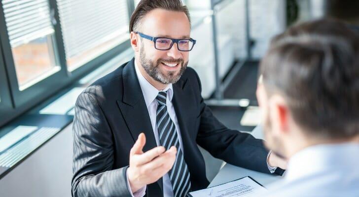 Financial advisor talks with client