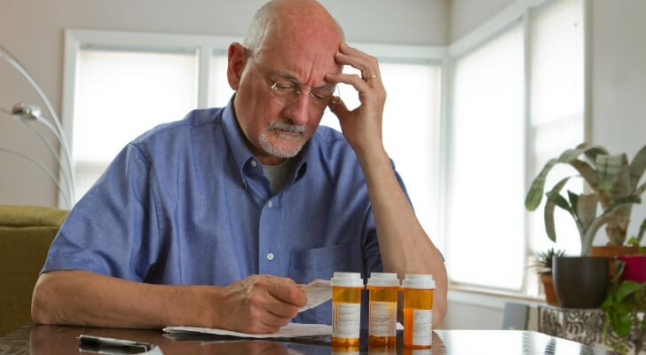Older man trying to figure out how to pay his medical bills