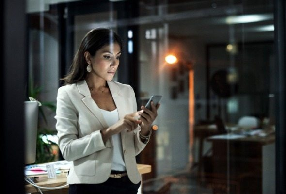 woman in office on her phone - banks