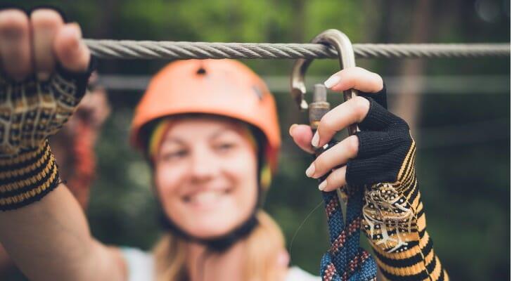 Woman adjusting zipline