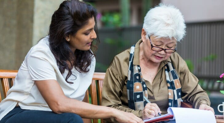Senior woman signs a living will