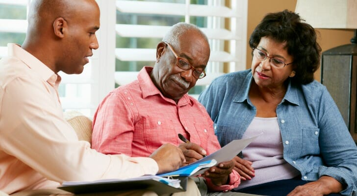 Retired couple working with their lawyer on an estate plan