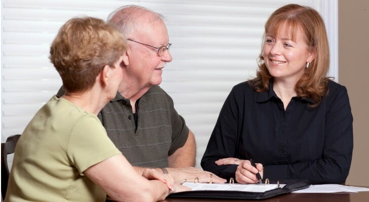 Older couple working with a financial advisor on their estate plan